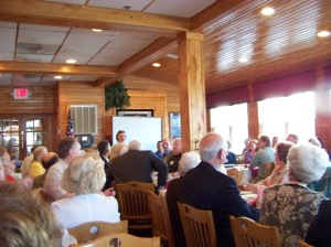 President Jean Tomes addresses members at the annual meeting and banquet at Smithfield Station Restaurant.